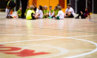 Physical Education Class. Indoor Soccer Training. Kids Futsal Team with Coach. Youth Sport Background